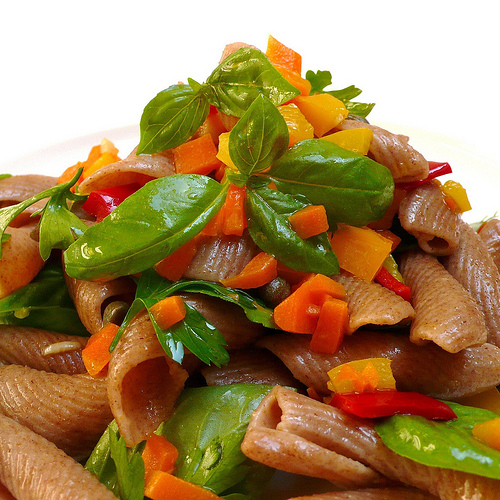 Whole grain farro pasta with peppers, capers and fresh herbs