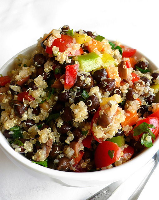 Quinoa and black chickpea salad with mixed vegetables and olives