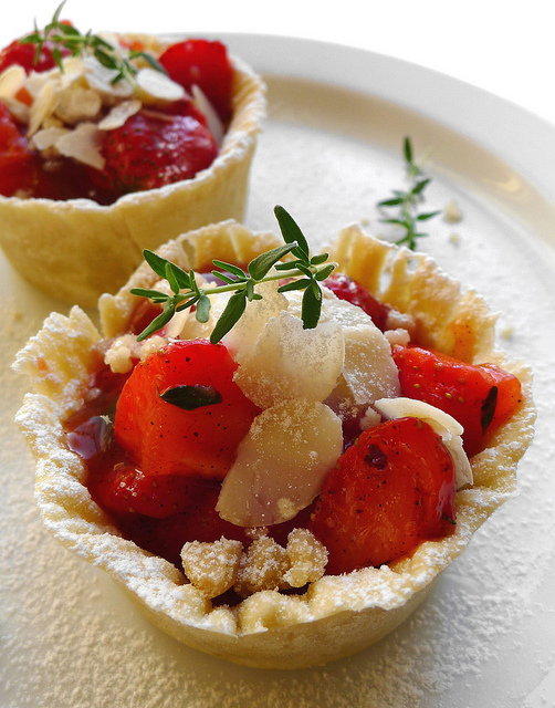 Strawberry, almond, thyme and vanilla tartlets