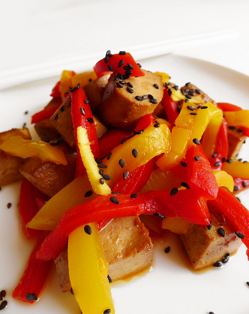 Tofu cubes with marinated peppers and sesame
